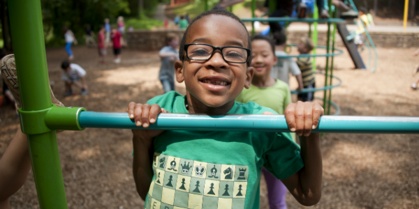 photo of a boy playing on a playground