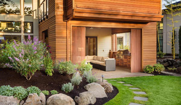 image of a modern home with stately landscaping